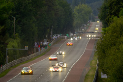 A pack of cars race down Hunaudières straight