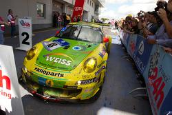 Race winner #18 Manthey Racing Porsche 911 GT3 RSR: Marc Lieb, Lucas Luhr, Romain Dumas, Timo Bernhard enters parc ferme