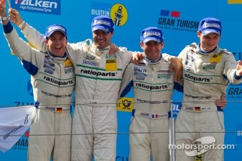 Podium: race winners Marc Lieb, Lucas Luhr, Romain Dumas, Timo Bernhard celebrates