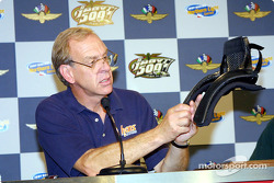 Robert Hubbard holding HANS device