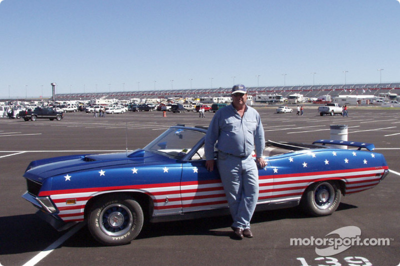 Jeff Mosley and his Torino with stars and strips decals in the infield