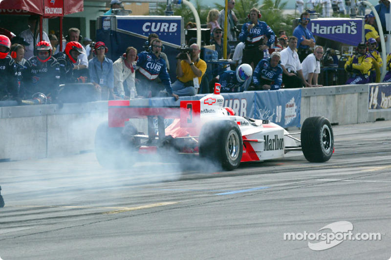 Helio Castroneves leaving the pits