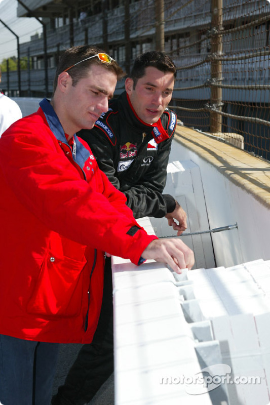Felipe Giaffone and Max Papis examining the new SAFER wall