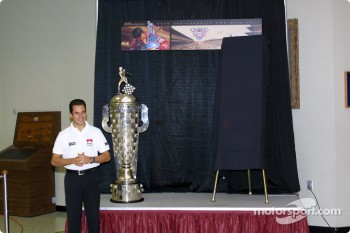 2001 Indy 500 Winner Helio Castroneves with the Borg Warner Trophy; the press conference was held to unveil the Indy 500 2002 race day ticket and the Borg Warner Trophy, which now has the face of last years winner on the famous trophy