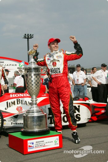 Race winner Dan Wheldon celebrates