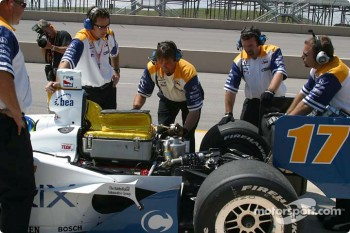 Vitor Meira's crew works to replace shocks