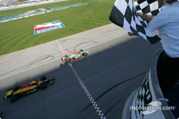 Adrian Fernandez takes the checkered flag in front of Bryan Herta