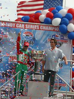 IRL 2004 champion Tony Kanaan celebrates with Tony George