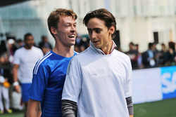 (L to R): Daniil Kvyat, Scuderia Toro Rosso with Esteban Gutierrez, Haas F1 Team at a charity football match