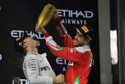 Second place Nico Rosberg, Mercedes AMG F1 celebrates his World Championship on the podium with Sebastian Vettel, Ferrari