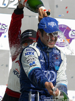 The podium: champagne for Dario Franchitti and Tony Kanaan