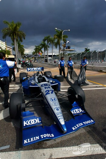 Dario Franchitti's Team KOOL Green car under dark sky