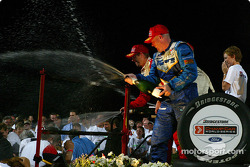 The podium: champagne for Sébastien Bourdais with Paul Tracy and Bruno Junqueira