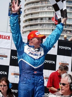 Race winner Paul Tracy celebrates
