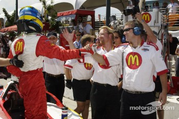 Sébastien Bourdais celebrates pole position with Newman Haas team members