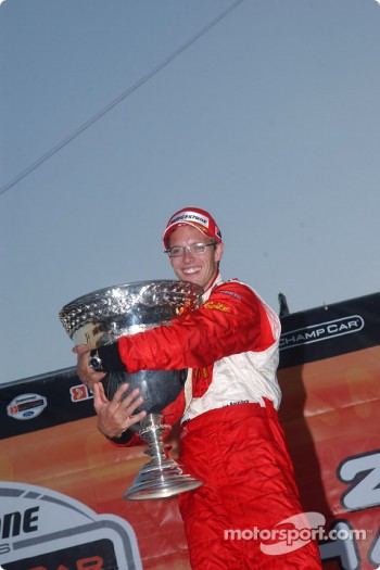 2004 Champ Car World Series champion Sbastien Bourdais celebrates with the Vanderbilt Cup