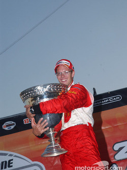 2004 Champ Car World Series champion Sébastien Bourdais celebrates with the Vanderbilt Cup