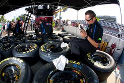 Hendrick Motorsports Chevrolet team member prepares wheels