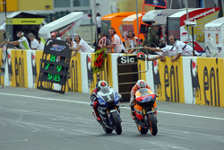 Casey Stoner, Repsol Honda Team and Jorge Lorenzo, Yamaha Factory Racing battle