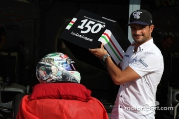 Vitantonio Liuzzi, HRT F1 Team, shows his special new helmet for this Italian Grand Prix