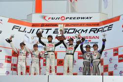 GT300 podium: winners Nobuteru Taniguchi and Taku Bamba