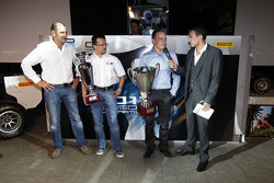Guillarne Capictto from Lotus ART collects the winning GP3 teams trophy with Valtteri Bottas, collecting the GP3 champions trophy with Bruno Michel and Will Buxton