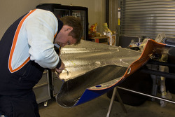 Crew working on the #007 Aston Martin Racing AMR/Lola Coupe B09/60: Adrian Fernandez, Harold Primat, Stefan Mücke