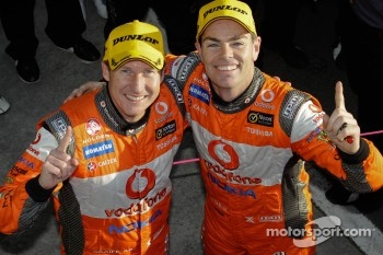 Race winners Craig Lowndes and Mark Skaife celebrate