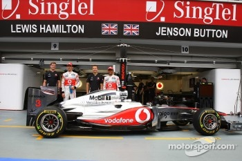 Jenson Button, McLaren Mercedes with Lewis Hamilton, McLaren Mercedes, and their trainers with a new sponser Lucozade