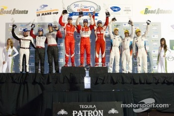 GT podium: class winners Giancarlo Fisichella, Gianmaria Bruni and Pierre Kaffer, second place Bill Auberlen, Dirk Werner and Augusto Farfus Jr., third place Jörg Bergmeister, Patrick Long and Patrick Pilet