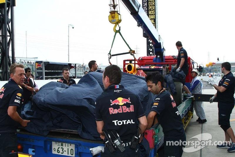 Sebastian Vettel, Red Bull Racing car is taken back to the pit lane