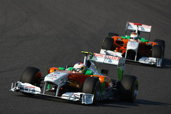 Paul di Resta, Force India F1 Team leads Adrian Sutil, Force India F1 Team