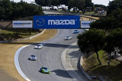 Cars on course during the Porsche Rennsport Reunion IV at Mazda Raceway Laguna Seca