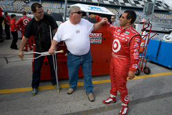 Juan Pablo Montoya shares a laugh with team members