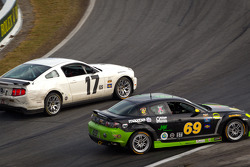 #17 BTE Sport Mustang Boss 302R: Emmanuel Anassis, Anthony Massari and #69 Pirate Motorsports Mazda RX-8: M Allen Milarcik, Mike Slutz collide