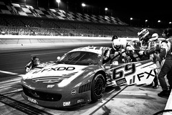 Pit stop for #69 AIM Autosport Team FXDD Racing with Ferrari Ferrari 458: Emil Assentato, Anthony Lazzaro, Nick Longhi, Jeff Segal