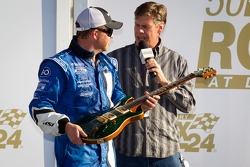 DP victory lane: Michael Shank accepts the guitar given to the winning team owner