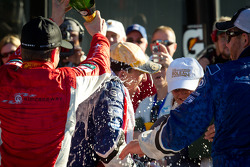 DP podium: Allan McNish and A.J. Allmendinger celebrate