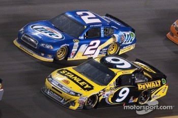 Marcos Ambrose, Richard Petty Motorsports Ford and Brad Keselowski, Penske Racing Dodge