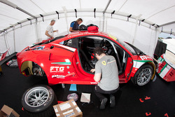 AF Corse team members at work