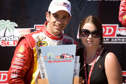 Podium: race winner Helio Castroneves, Team Penske Chevrolet with Holly Wheldon, sister of the late Dan Wheldon