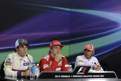 Race winner Fernando Alonso, Scuderia Ferrari, second place Sergio Perez, Sauber F1 Team, third place Lewis Hamilton, McLaren Mercedes