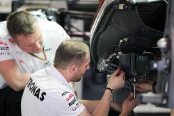 Mercedes AMG F1 mechanics work on the Mercedes AMG F1 W03