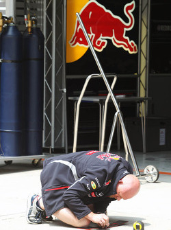 Red Bull Racing mechanic prepares in the pits