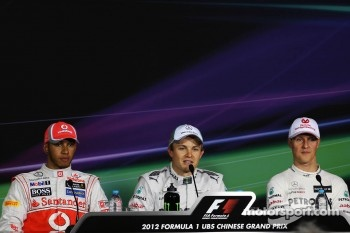 Qualifying top three in the FIA Press Conference, Lewis Hamilton, McLaren, second; Nico Rosberg, Mercedes AMG F1, pole position; Michael Schumacher, Mercedes AMG F1, third