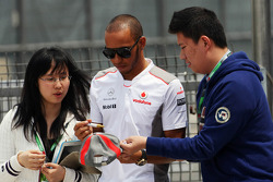 Lewis Hamilton, McLaren Mercedes signs autographs for the fans