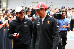 Pedro De La Rosa, HRT Formula 1 Team with Jenson Button, McLaren Mercedes on the drivers parade