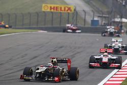 Kimi Raikkonen, Lotus leads Lewis Hamilton, McLaren