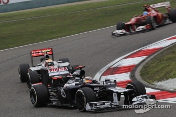 Pastor Maldonado, Williams F1 Team leads Lewis Hamilton, McLaren Mercedes