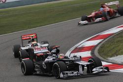 Pastor Maldonado, Williams F1 Team leads Lewis Hamilton, McLaren Mercedes